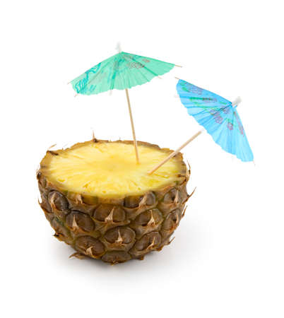 Pinapple and umbrellas on a white background. Isolated path included.