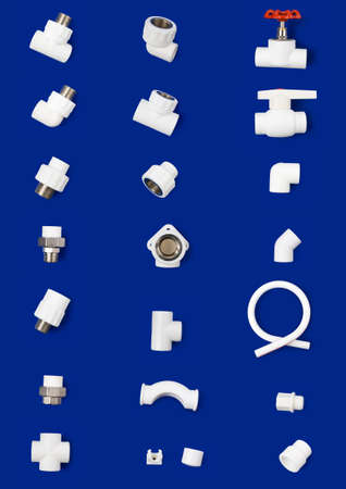 Set of white plastic fittings to use in hot and cold water supply lines. Blue background.