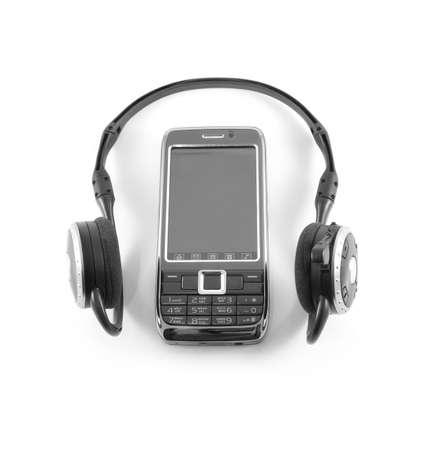 black wireless headphones and telephone ona white background photo