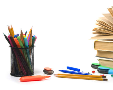 Office supplies and books on a white background. photo