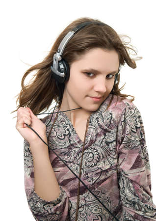 Teenage girl listening music on a white background