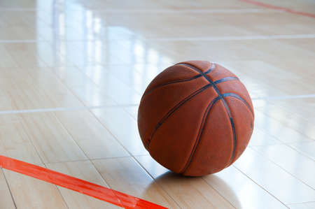 Basketball over wooden floor. Close up. Stock Photo - 9897897