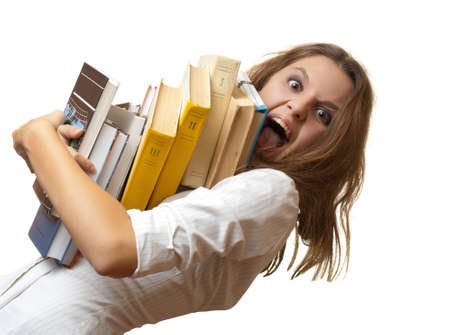 Screaming teenage schoolgirl panicking with pile of book. Isolated on a white background.