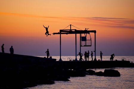 People on the beach on sunset photo
