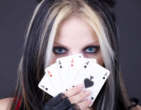 Girl holds five playing cards