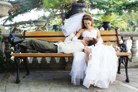 bride and groom on the bench photo