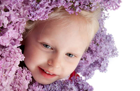 gaily: beautiful little girl with branch of lilac