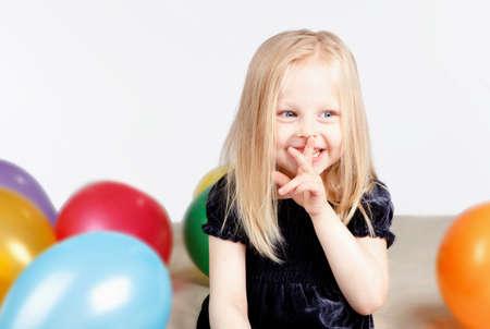 little girl with balloons photo