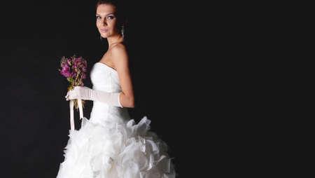 Brunet bride portrait in studio isolated on black