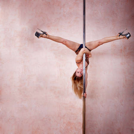 poledance: Girl making figure of poledance sport Stock Photo