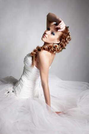 wedding hairstyle: Beautiful blond bride portrait in studio Stock Photo
