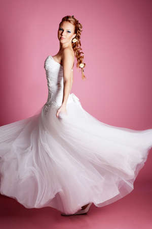 Beautiful blond bride portrait in studio photo