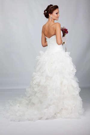 Brunet bride portrait in studio photo