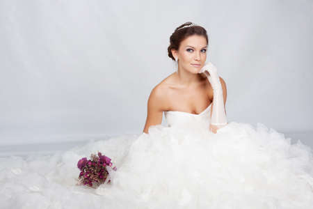 Brunet bride portrait in studio photo