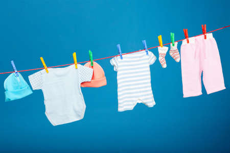 dirty clothes: Baby laundry hanging onthe rope Stock Photo