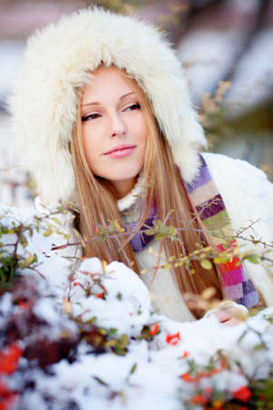 Beautiful blond hair girl i winter clothes photo