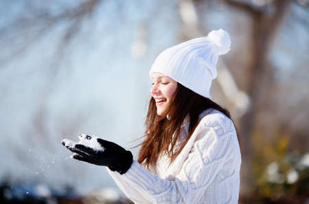 Girl playing with snow in park Banco de Imagens