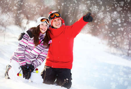 Girl and boy in winter park photo