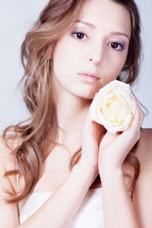 Girl with rose flower in hands Stock Photo - 12326270