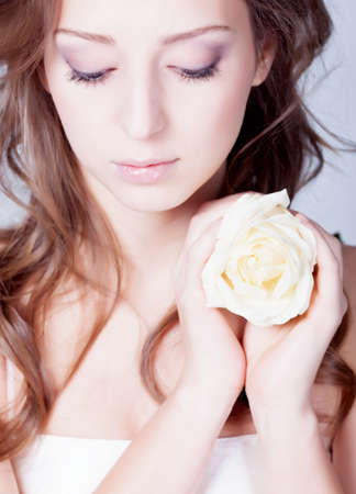 Girl with rose flower in hands Stock Photo - 12326281