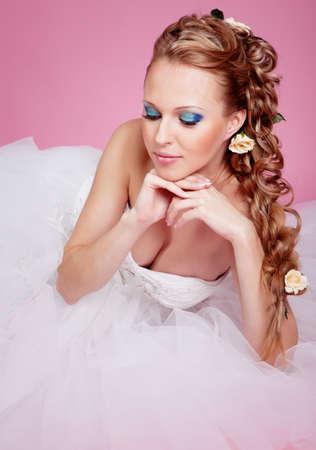 Beautiful blond bride photo in studio Stock Photo - 12604325