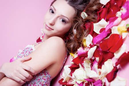 Beautiful girl with rose petals
