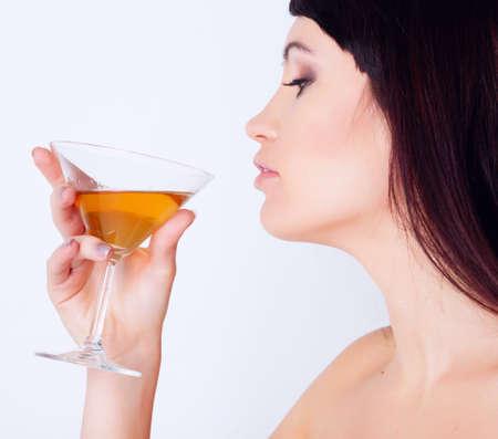Girl drinking wine in studio Stock Photo - 12604102