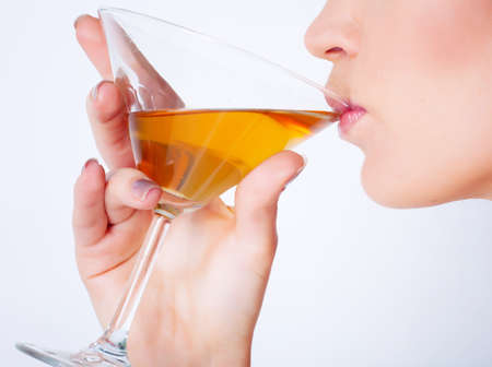 Girl drinking wine in studio photo