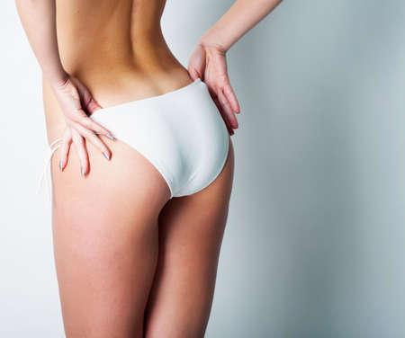 Girl in white swimsuit in studio Stock Photo - 12604132