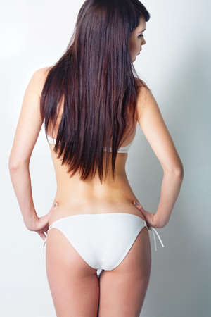 Girl in white swimsuit in studio Stock Photo - 12604347