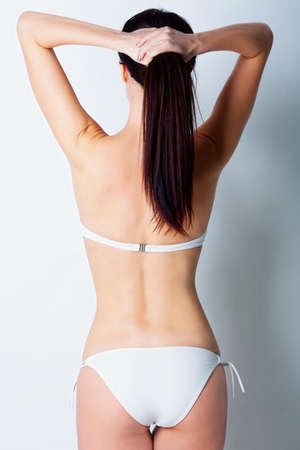 Girl in white swimsuit in studio Stock Photo - 12604258