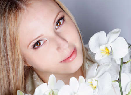 Girl with white orchid in studio Stock Photo - 12604210