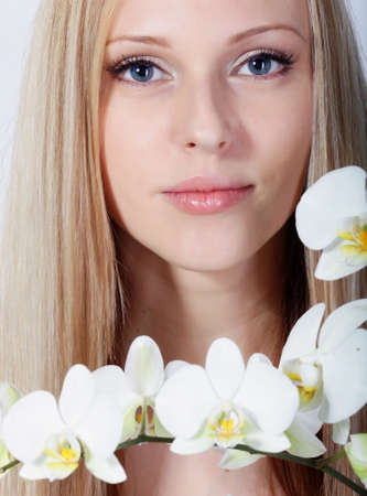 Girl with white orchid in studio Stock Photo - 12604088