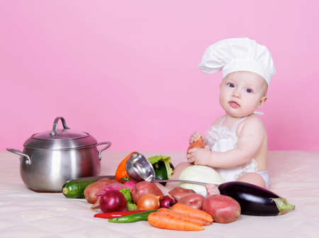 Little baby cook in studio photo