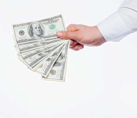 A man s hand holding a handful of dollars photo