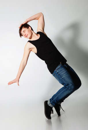 Young man dancing in studio photo