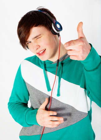 Young man listening music in studio photo
