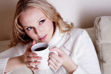 Beauriful girl drinking coffee at home photo