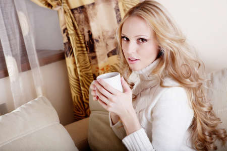 Beauriful girl drinking coffee at home Stock Photo - 12604538