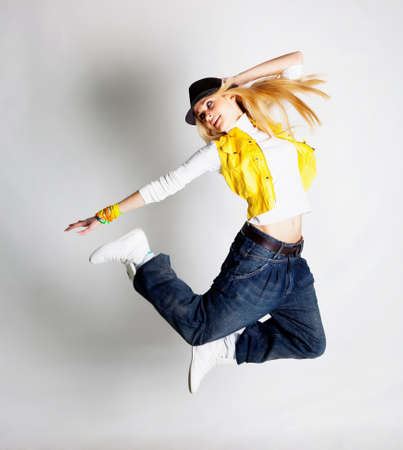 Beautiful blond hair girl dancing hiphop photo