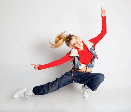 Beautiful blond hair girl dancing hiphop photo