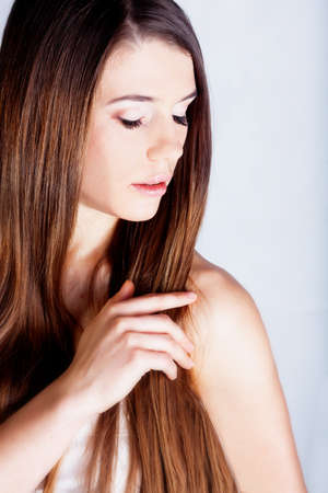 Beautiful brunette girl with long hair Stock Photo - 12726281