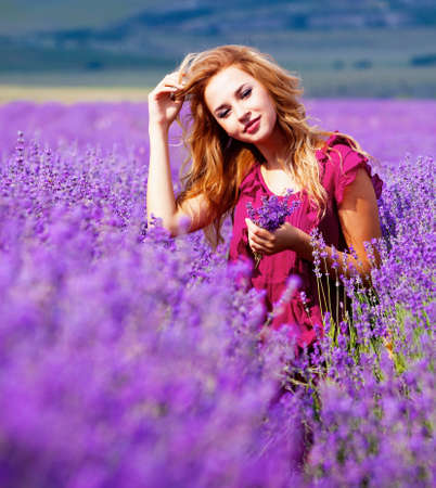 purple dress: Beautiful blond hair girl in lavender meadow