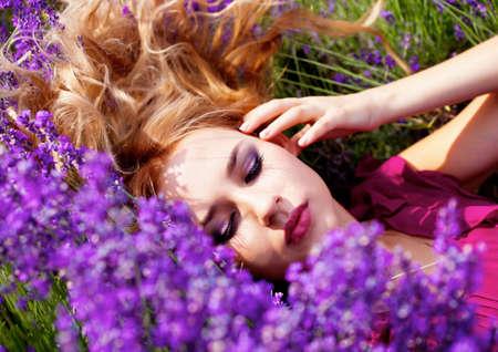Beautiful blond hair girl in lavender meadow