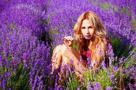 Beautiful blond hair girl in lavender meadow Banco de Imagens - 12726310