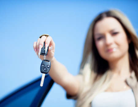Girl showing the car key in hand photo