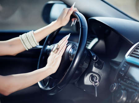 Beautiful girl hands on the drivewheel of car Stock Photo - 12897128