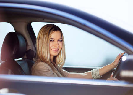 Beautiful blond girl in her car photo