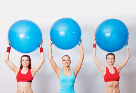 Three girls with fitballs in hands photo