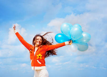 Girl with balloons under blue sky with clouds Stock Photo - 12980968
